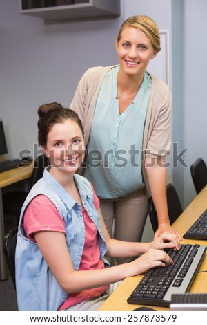 Students working on computer together at the university - stock photo