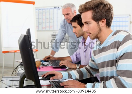 Students working on computers - stock photo