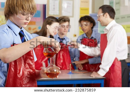 Students Working on Experiment - stock photo