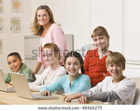 Students working on laptops - stock photo