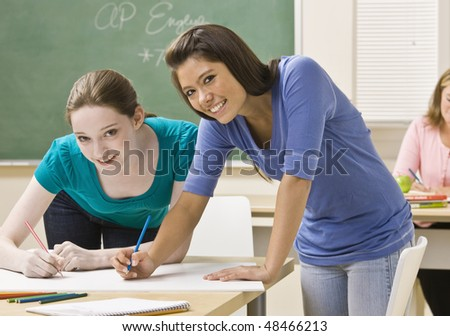 Students working on project in classroom - stock photo