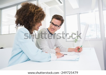 Students working together in class at the college - stock photo