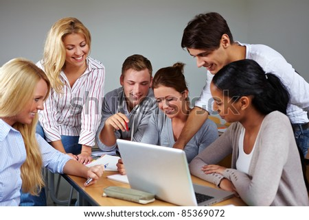 Studients doing group work in university class - stock photo