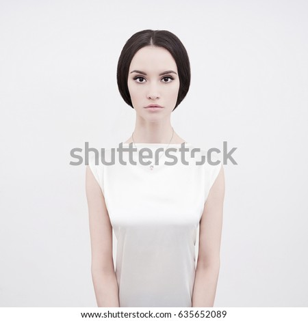 Studio art fashion photo of natural beautiful yong woman on white background. Health and beauty