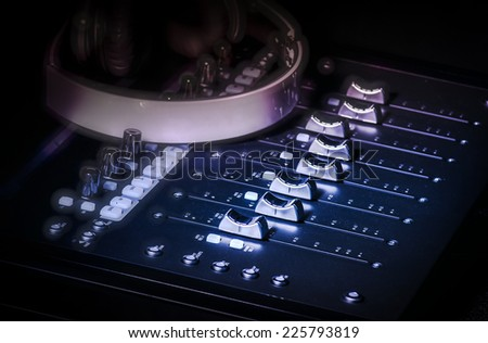 Studio audio sound console and headphones - stock photo