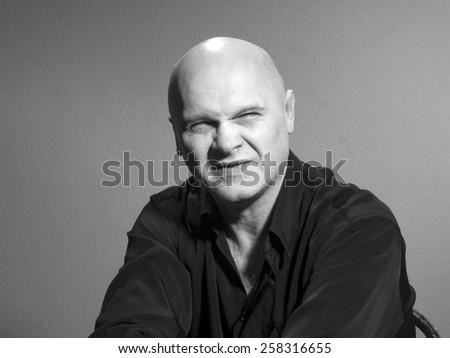 Studio black and white portrait caucasian bald men. Emotions. contempt - stock photo