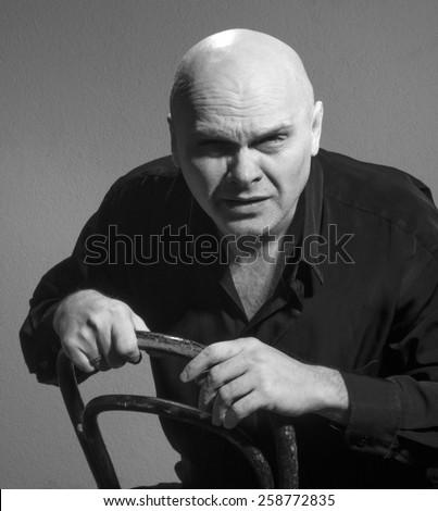 Studio black and white portrait caucasian bald men. Emotions. suspicious - stock photo