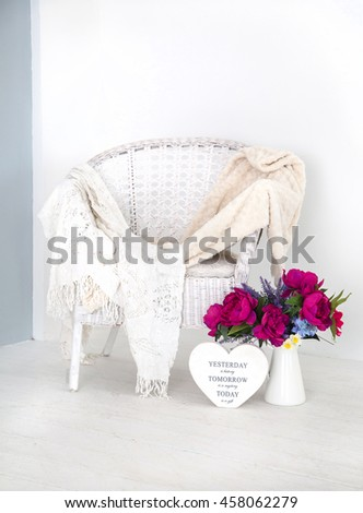 Studio. chair, flowers. a heart - stock photo