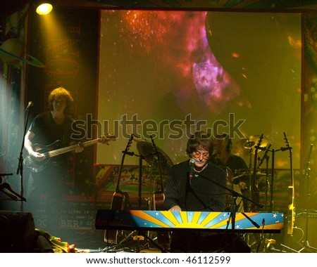 STUDIO CITY, CA - JAN 28:Tim Piper (seated, front) performs as John Lennon at The Platinum theatre on January 28, 2009 in Studio City, California. - stock photo