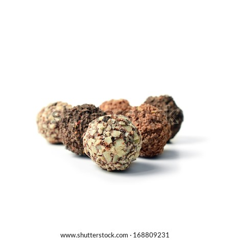 Studio close-up of assorted truffles against a white background with soft shadows. Copy space. - stock photo