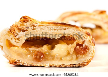 Studio close up of delicious apfelstrudel (apple pie) isolated on white background - stock photo