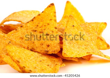 Studio close up of nachos (mexican chips) isolated on white background