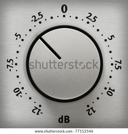 Studio closeup of a metallic volume knob with numbers from -12 to 12 dB - stock photo