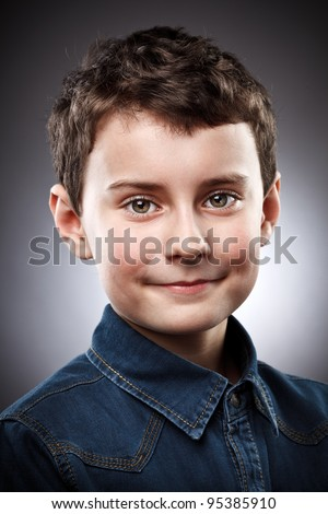 Studio closeup portrait of a smiling boy