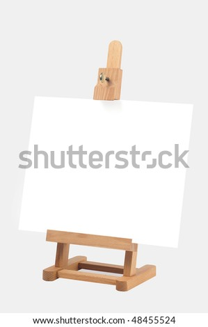 Studio easel with canvas isolated on white background - stock photo