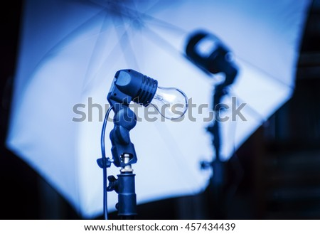 Studio Equipment. Incandescent, flash and photo umbrella