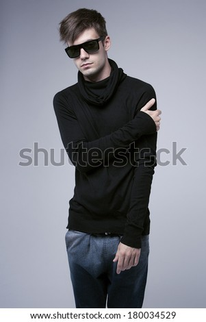 Studio fashion look of stylish guy. Isolated on grey background. - stock photo