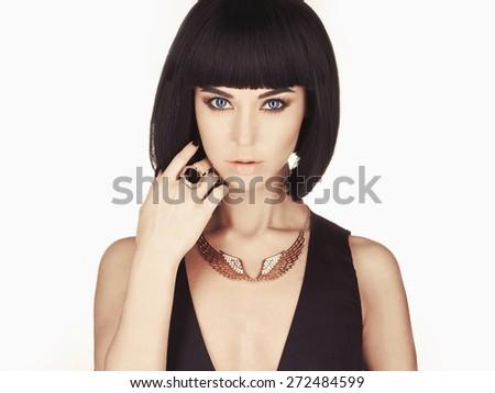 Studio fashion photo of beautiful stylish woman. Girl with bob hair - stock photo