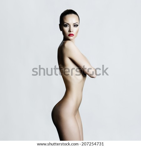 Studio fashion photo of elegant naked lady - stock photo