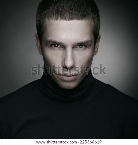 Studio fashion portrait of a young handsome man. - stock photo