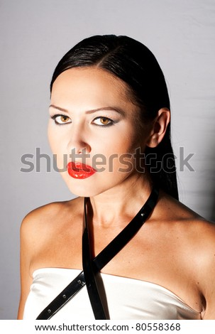 studio fashion portrait of beautiful young woman - stock photo