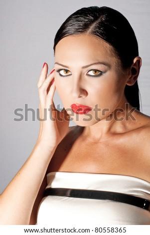studio fashion portrait of beautiful young woman, glamour - stock photo
