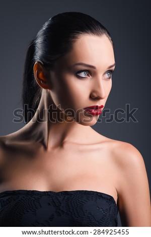 Studio fashion shot: portrait of a beautiful young woman - stock photo