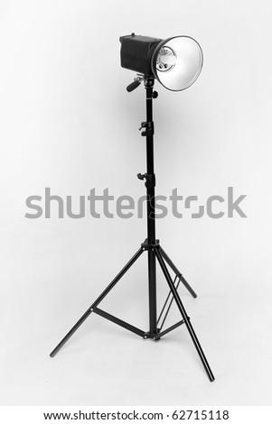Studio flash on light grey background - stock photo