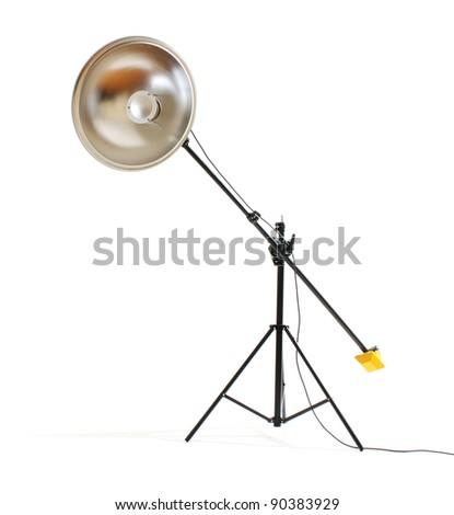 Studio flash with beauty dish on white background - stock photo