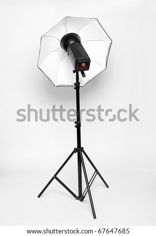 Studio flash with soft-box on a white background. - stock photo