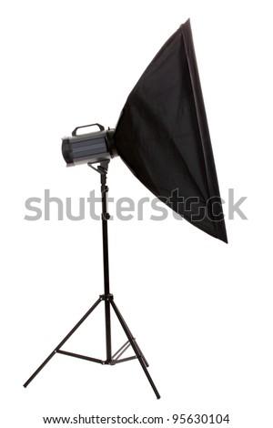 Studio flash with soft-box on white background - stock photo