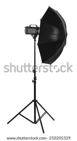 Studio flash with umbrella isolated on white - stock photo