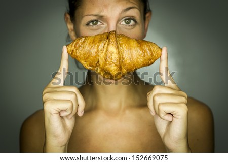 Studio, Frau mit Croissant - stock photo