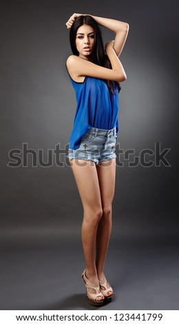 Studio full length portrait of a gorgeous hispanic young woman