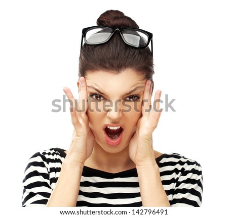 Studio head shot of a young angry  woman screaming.White background - stock photo