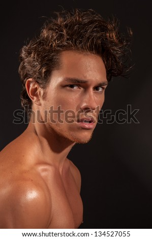 Studio headshot of young sexy male adult. - stock photo