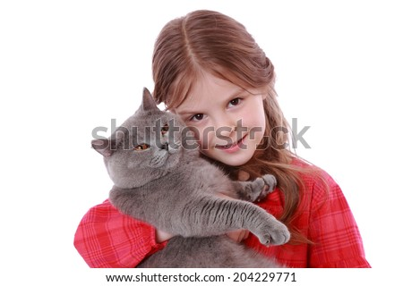 Studio image of a cheerful little girl played with a British breed of cat over white background/Smiley romantic little girl with cat - stock photo