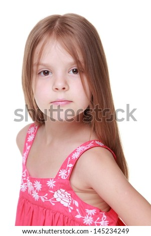 Studio image of a healthy little girl with long hair and beautiful smile isolated on white on Beauty and Fashion