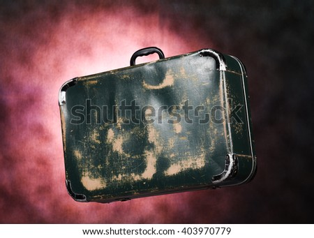 studio image of an old big leather travel suitcase - stock photo
