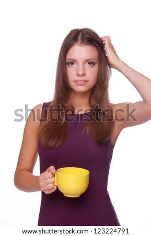 Studio image of beautiful young woman with cup of tea isolated on white on Food and Drink theme - stock photo