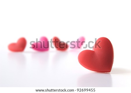 Studio image of five Valentine hearts with focus on the foreground. Isolated on white. Copy space.