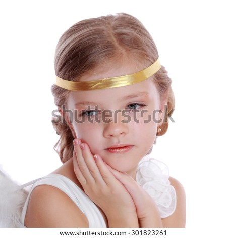 Studio image of lovely angelic little girl praying to the God on Christmas holiday isolated on white background/Pretty caucasian little angel looking up and praying gratefully  - stock photo