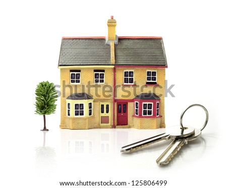 Studio image of modest 'first-time buyer' dwellings with white space, soft reflections and keys. Ideal for real estate, mortgage and home ownership concepts. Copy space. - stock photo
