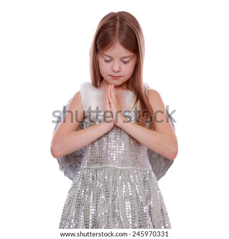 Studio image of silver little angel isolated on Christmas - stock photo