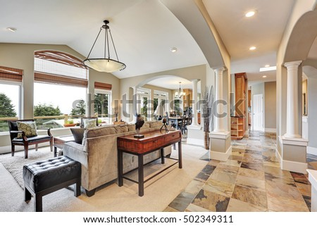 studio interior in luxurious house with arches and natural stone tile floor northwest usa - Natural Stone Tile