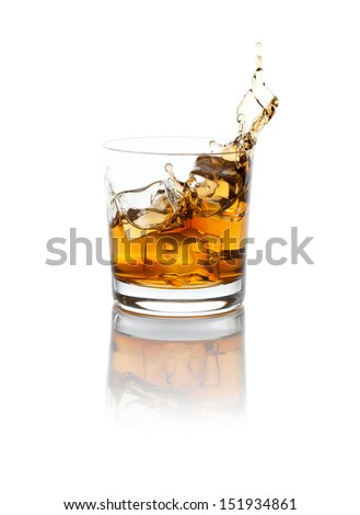 Studio isolated splashing whiskey over white background. Clipping path included. - stock photo