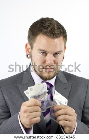 Studio Isolation of a single caucasian male. He has a serious look as he stares into the camera whilst he is handing over money in a business style concept.