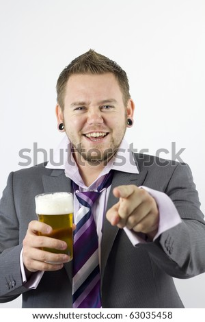 Studio Isolation of a single caucasian male. He is holding a very frothy pint of beer and has a rather drunken happy expression. The concept of office parties. He is also pointing towards the camera.