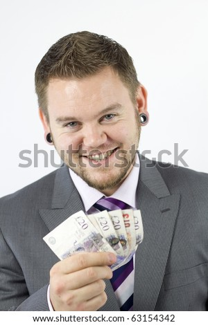 Studio Isolation of a single caucasian male. Holding a fan of english banknotes. Copy space above.