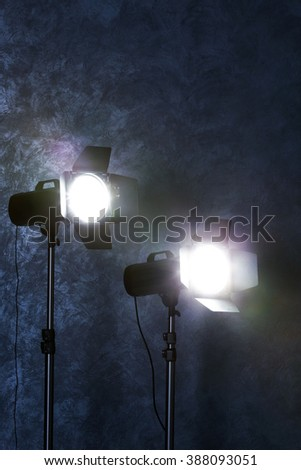 Studio light flashes on wall grey textured background - stock photo